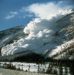An avalanche going down a mountain.